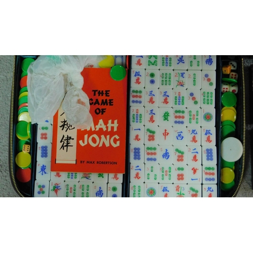 92 - A vintage green and white plastic hand carved tricolour Mahjong set in leather effect zip up case. T...