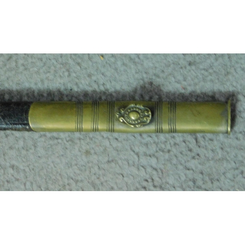 198 - A late 19th century Masonic ceremonial sword, with bass handles, brass and leather scabbard, the 83c...