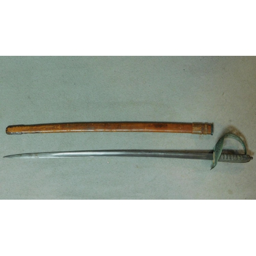 200 - An antique cavalry sword with leather scabbard and pierced and engraved pattern scroll hilt. W.100cm...
