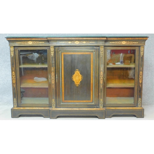 18 - A late Victorian ebonised and satinwood inlaid credenza with ormolu mounts and central panel door fl...