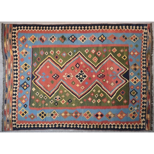 258 - A Qashqai Kilim with central repeating medallion on multi coloured ground within stylised flowerhead...
