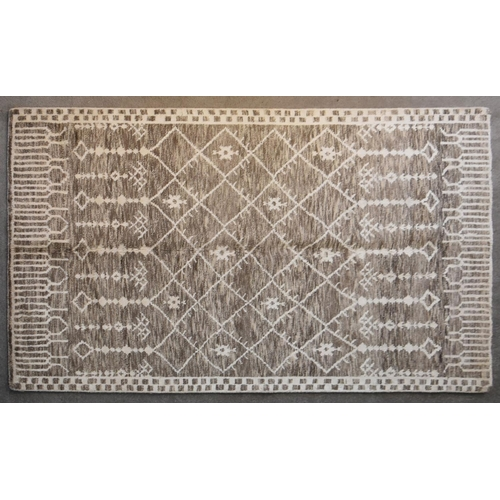 266 - A Moroccan rug with repeating geometric, flowerhead and pendant design on a taupe ground. L.242x155c...
