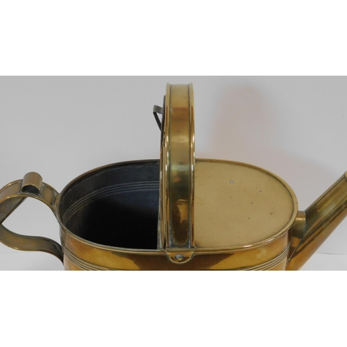 12 - A 19th century brass watering can with makers trade mark to the base. H.43 W.53 D.21cm...