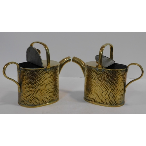 13 - A pair of small brass 19th century conservatory watering cans with maker's stamp to the base. H.22 W...