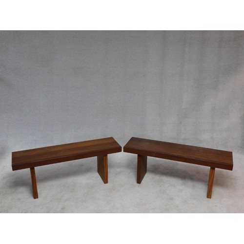 170 - A pair of African hardwood benches with planked tops on block trestle supports. H.47 W.104 D.42cm...