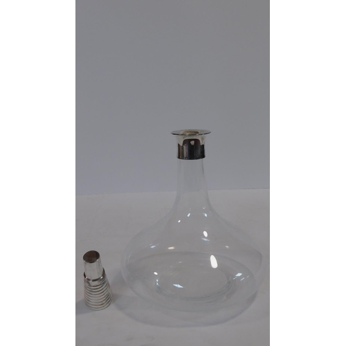 60 - A silver plated and crystal Cristofle wine decanter. The matching stopper has a ribbed design and it...
