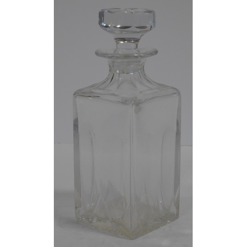 61 - A Cartier French cut square crystal decanter with star cut design stopper. Signed to the base. H.25c...