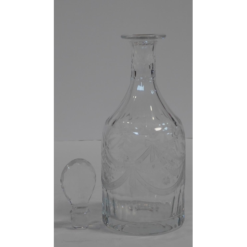 62 - A William Yeoward engraved crystal decanter with fern, floral and ribbon swag design. A faceted tear...