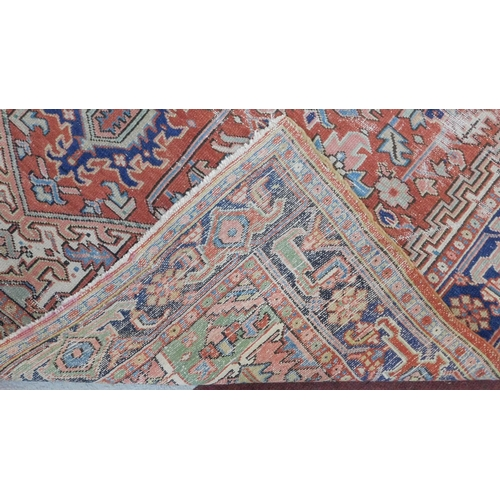 248 - A Persian carpet with central pendant medallion and spandrels on burgundy ground within foliate midn...