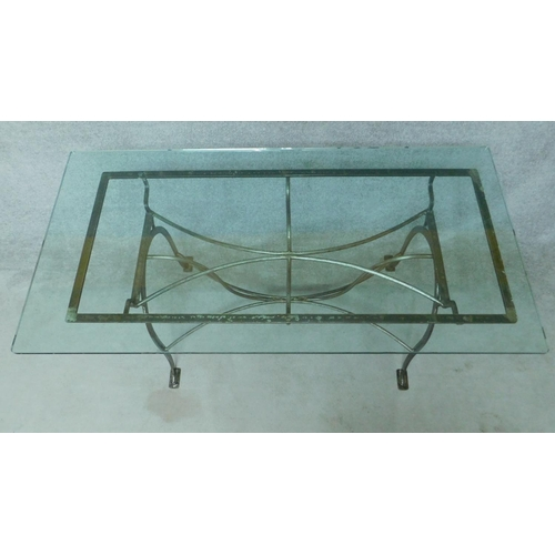247 - A wrought iron conservatory table with plate glass top. H.77 W.160 D.80cm...