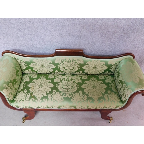 19 - A small Regency mahogany framed scroll arm sofa in newly upholstered emerald floral damask raised on...