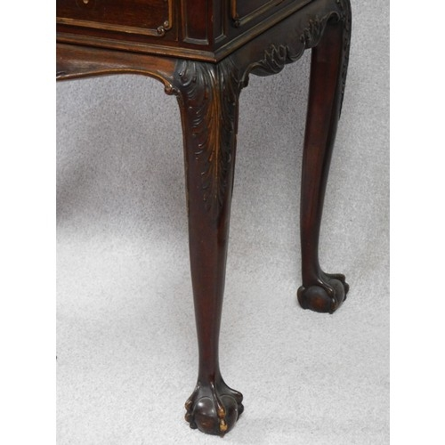 20 - A 19th century mahogany side table in the Irish Georgian style with frieze drawer above carved friez...