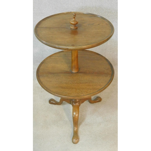 3 - A 19th century mahogany two tier dumb waiter with turned finial to the top and central column on cab...