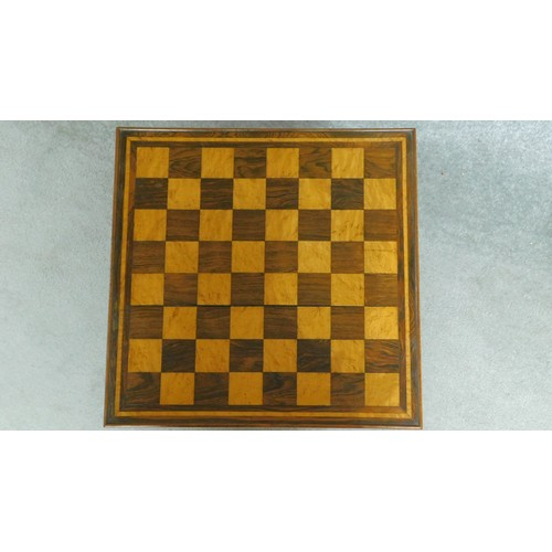 4 - A 19th century carved rosewood chess table with burr maple inlaid chequerboard top on central column...