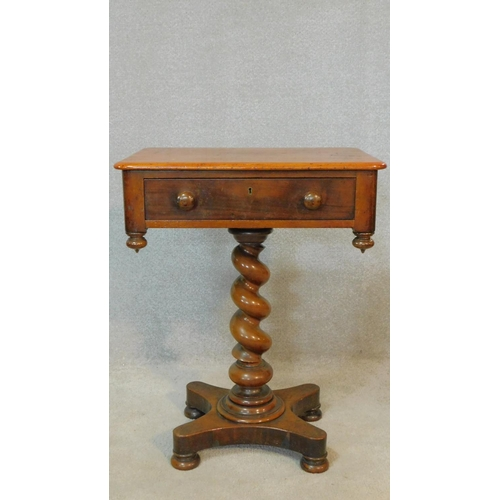 5 - A 19th century mahogany occasional table with frieze drawer opposing dummy drawer on spiral twist ce...