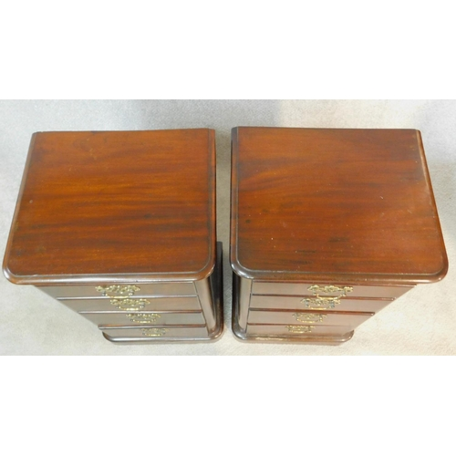 6 - A pair of 19th century walnut chests of four graduating drawers on plinth bases. H.77 W.44 D.36cm