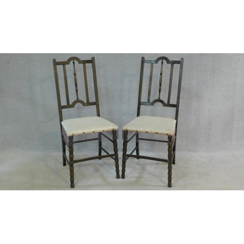 8 - A pair of late 19th century stained beech bedroom chairs on stretchered bobbin turned supports. H.91...