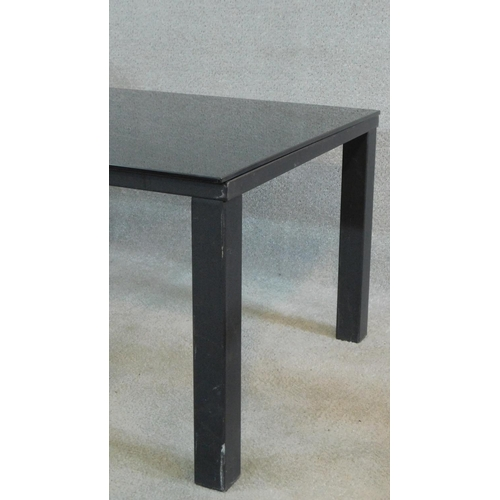 147 - A contemporary low table with dark plate glass top on metal framed base. H.46 L.120 D.65cm...