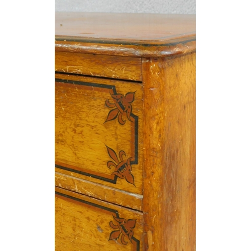9 - A Victorian painted pine chest of two short above three long graduating drawers with ceramic knob ha...