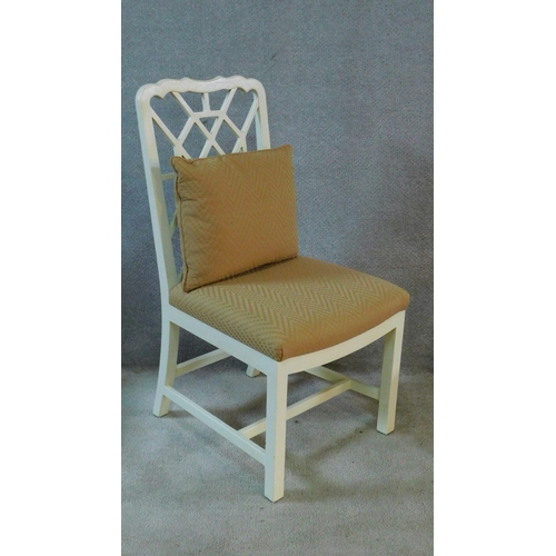 148 - A set of eight white painted Chinese Chippendale style dining chairs with beige upholstered stuffove...