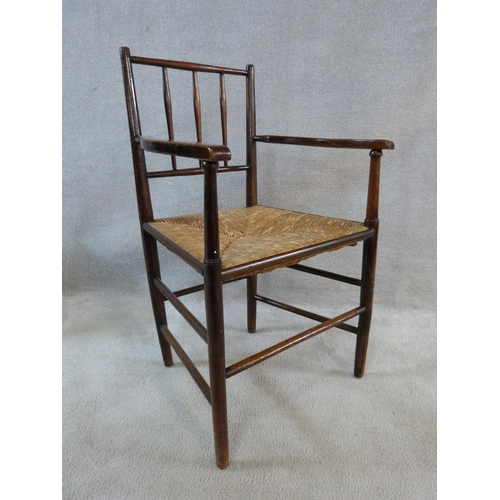 17 - A set of six beech Sussex style chairs in the manner of Morris and Co. with spindle backs and woven ...