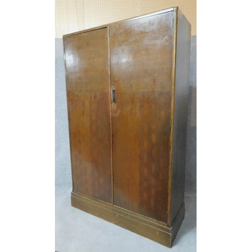 78 - A vintage fitted oak gentleman's wardrobe with slides, drawers and hanging space, patented by Compac...