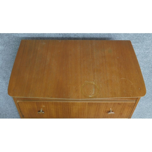 79 - A mid century vintage teak tallboy chest of six drawers. H.126 W.67 D.42cm...