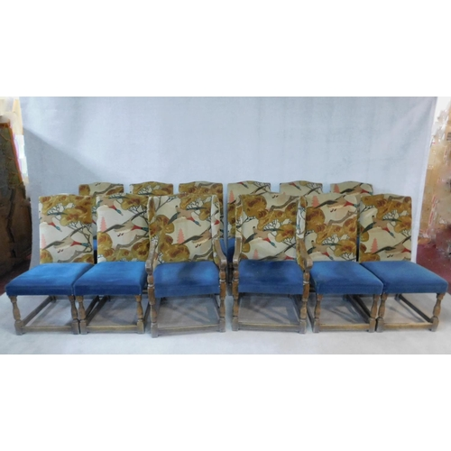 80 - A set of twelve Jacobean style oak dining chairs in Arts and Crafts flying duck motif upholstery on ...