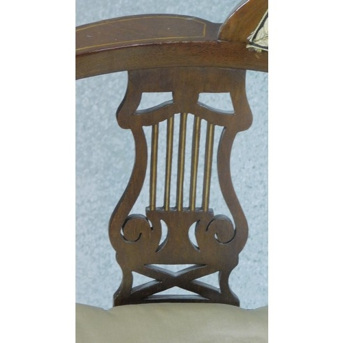 125 - An Edwardian mahogany corner chair with lyre carved splats on turned stretchered supports. H.72cm