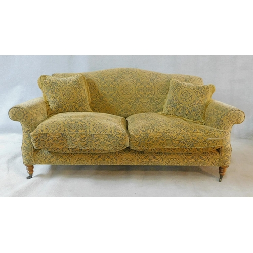 235 - A Georgian style Beaumont and Fletcher sofa in pale gold and sage scrolling floral upholstery raised...