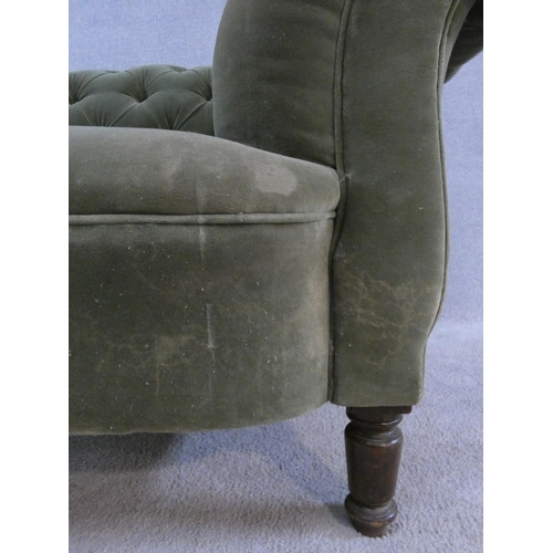 251 - A late 19th century buttoned back Chesterfield sofa upholstered in pale green on turned tapering sup...