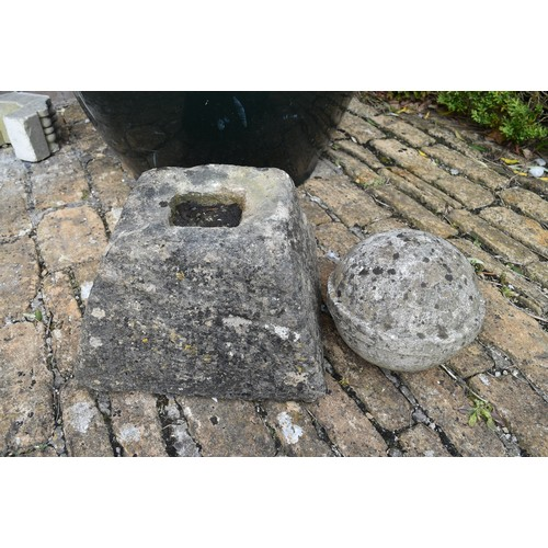 32 - A small carved stone garden pyramid and spherical finial. H. 50cm