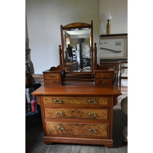 82 - A late 19th century straight grain and burr walnut dressing table with swing bevelled plate above an...