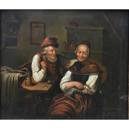 96 - A 19th century oil on board in ornate gilt frame, an old couple seated together, unsigned. H.34x37cm...