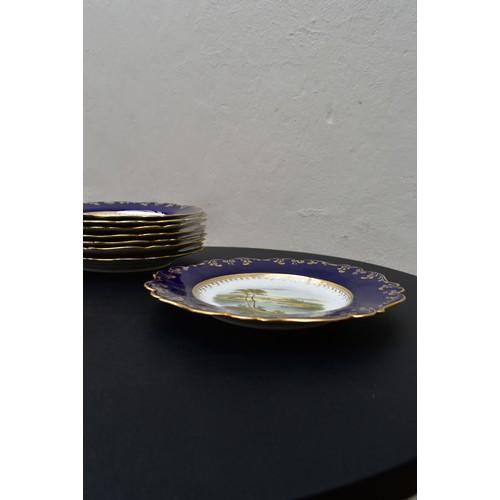 63 - A Royal Worcester style 19th century porclelain twelve piece dessert service, comprising a pair of c...