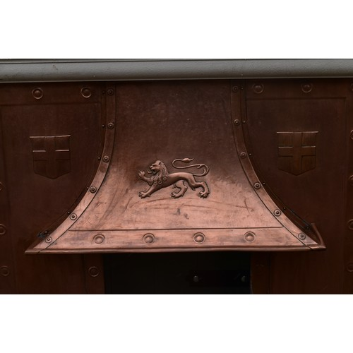 125 - A painted vintage fire surround with hammered and embossed copper hood and insert. H.190xW.140cm