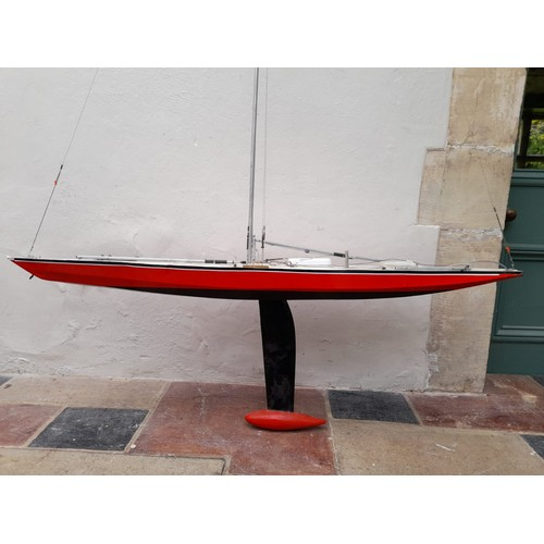 80 - A large scratch built model of a racing yacht fitted with removable hull, comes with a spare short m...