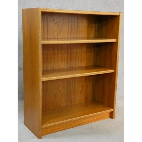 105 - A light oak open bookcase. H.103 W.83 D.22cm
