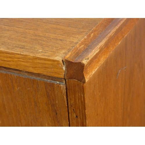 127 - A 1960's vintage teak compact sideboard by Meredews Furniture. H.72 W.124 D.45cm