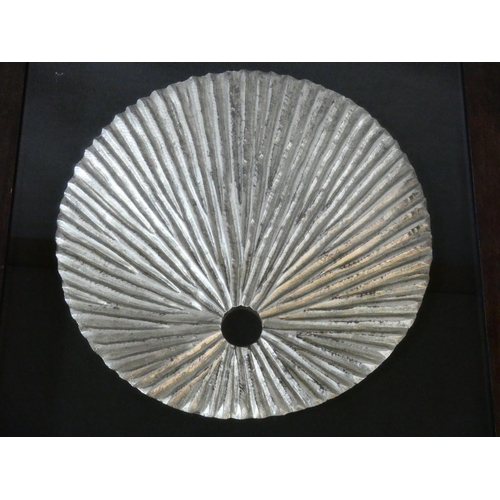 431 - A contemporary carved wood textured silver disk, mounted on black, shadow box framed. H.80 W.80cm