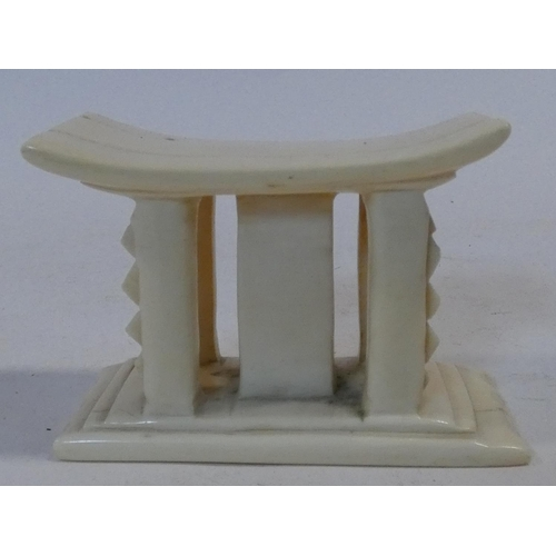 295 - An early 20th century carved ivory African miniature headrest/ashanti stool. H.7xW.10xL.5cm