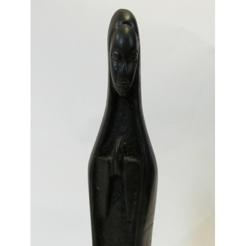 297 - A carved wooden female tribal sculpture. Mounted on a wooden block. H.37cm