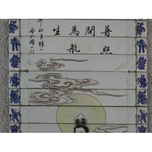 55 - A Republic period hand painted porcelain Chinese scroll with metal hanger. Depicts Guan-Yin standing...
