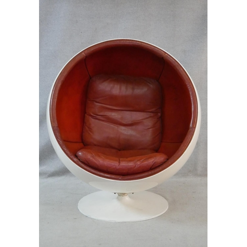 4 - After Eero Aarnio, a vintage white polyester Ball Chair on swivel metal base with burgundy leather u...