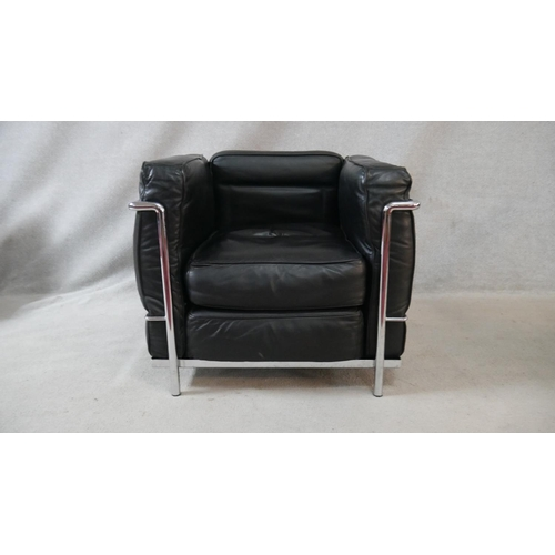295 - Le Corbusier, Charlotte Perriand, Pierre Jeanneret, a  mid century LC2 armchair in black leather uph...