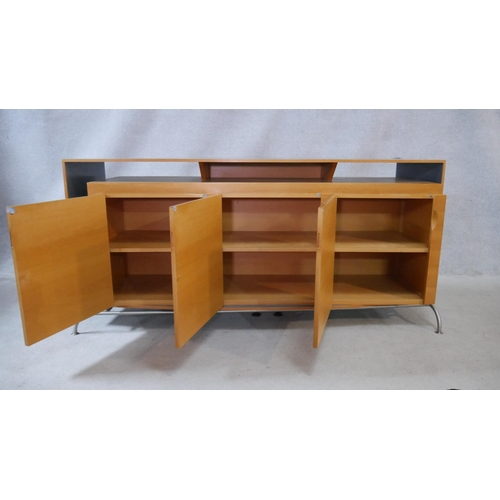 3 - A contemporary bespoke commissioned sideboard in laqcuered and polished blondewood on metal base. in...