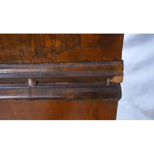 27 - A Queen Anne walnut and feather banded chest on stand with two short and three long graduated drawer...