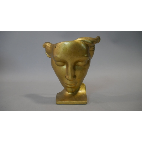 247 - A gilt metal mask on stand with impressed marks to the back, a medieval style carving and a vintage ...
