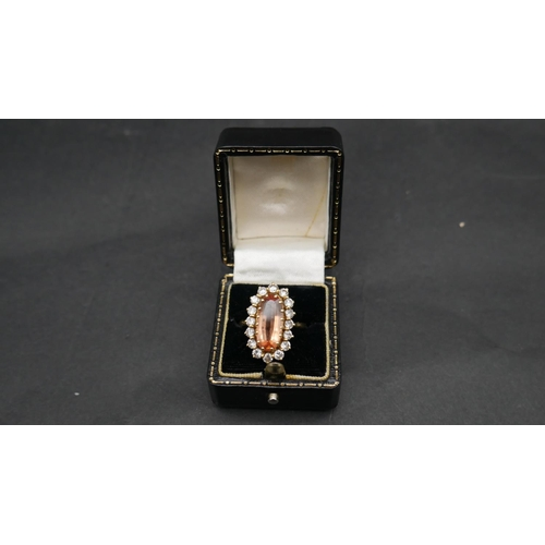 1 - A vintage 18ct yellow gold topaz and diamond oval cluster dress ring. Set with an oval mixed cut top...