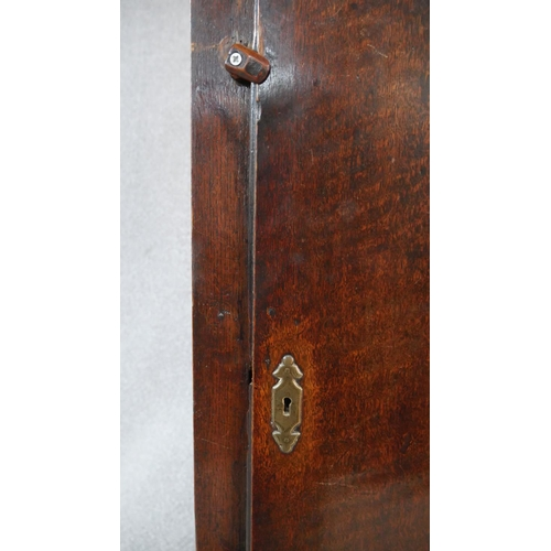 44 - A Georgian oak cased longcase clock by Charles Snuggs of Farnham with silvered dial and pierced bras...
